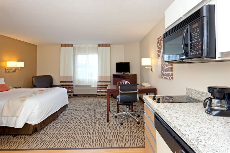 Guest Room At The Hawthorn Suites By Wyndham Detroit Farmington Hills In Michigan