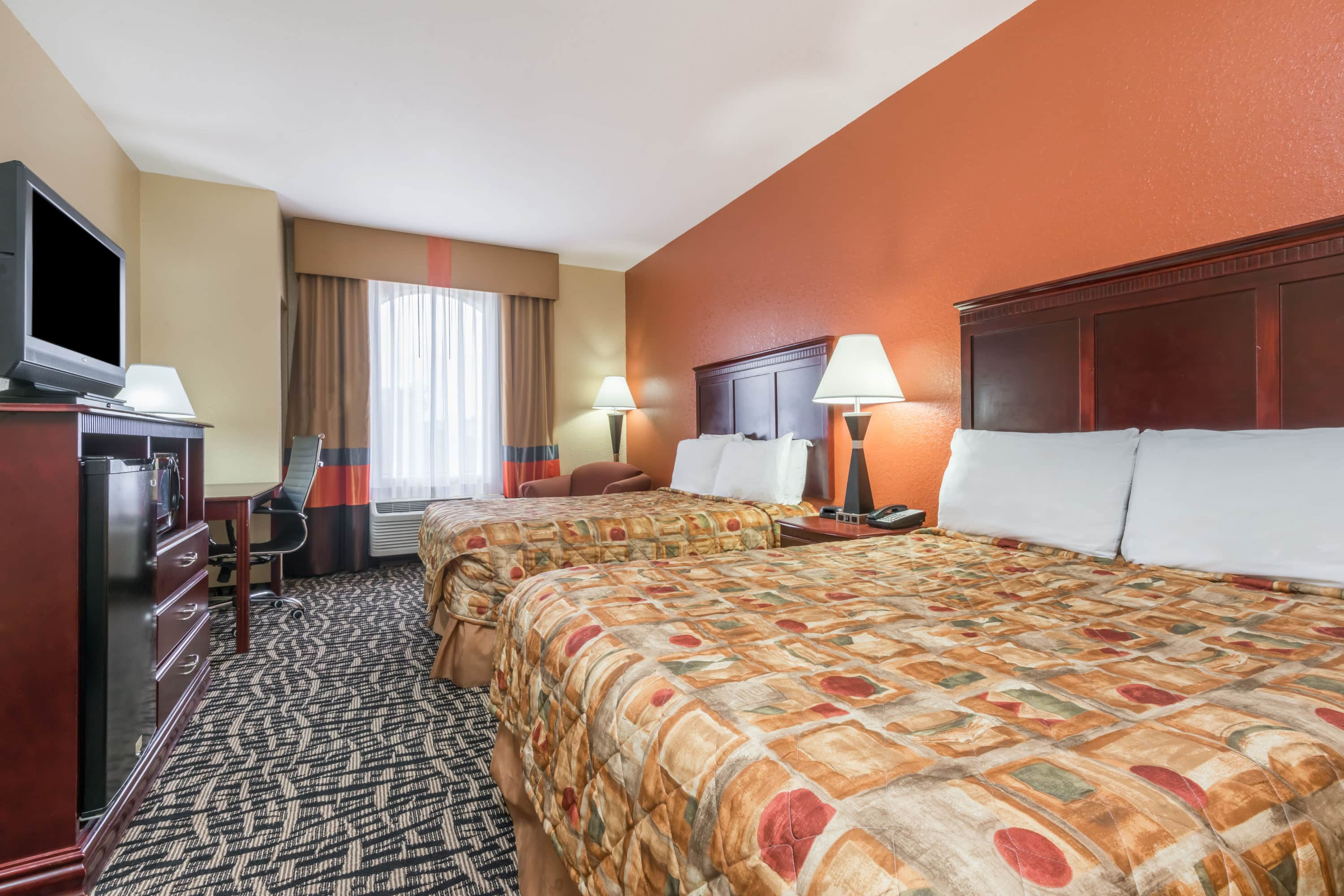 Guest room at the Days Inn & Suites Prattville-Montgomery in Prattville, Alabama