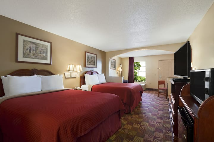 Guest room at the Days Inn & Suites Tuscaloosa - University of Alabama in Tuscaloosa, Alabama