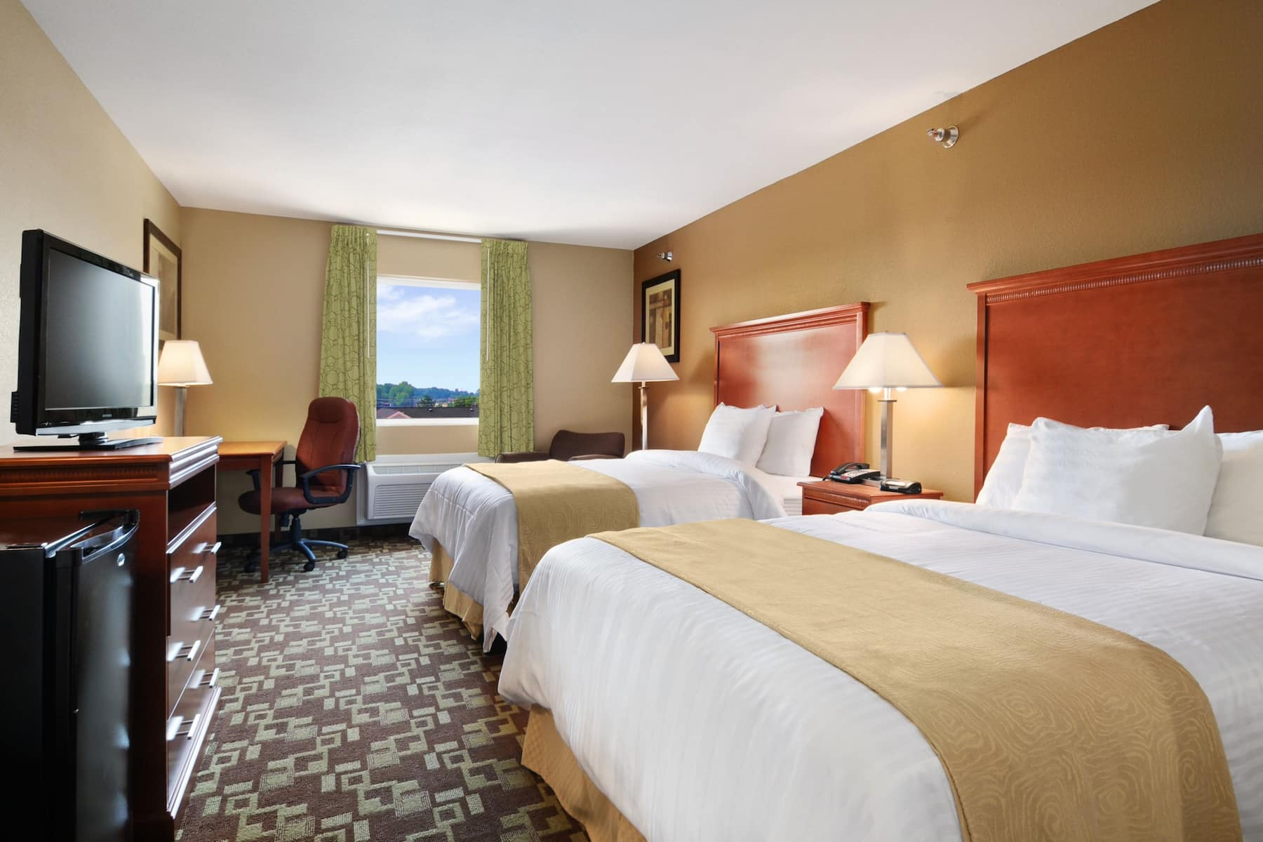 Guest room at the Days Inn & Suites by Wyndham Cabot in Cabot, Arkansas