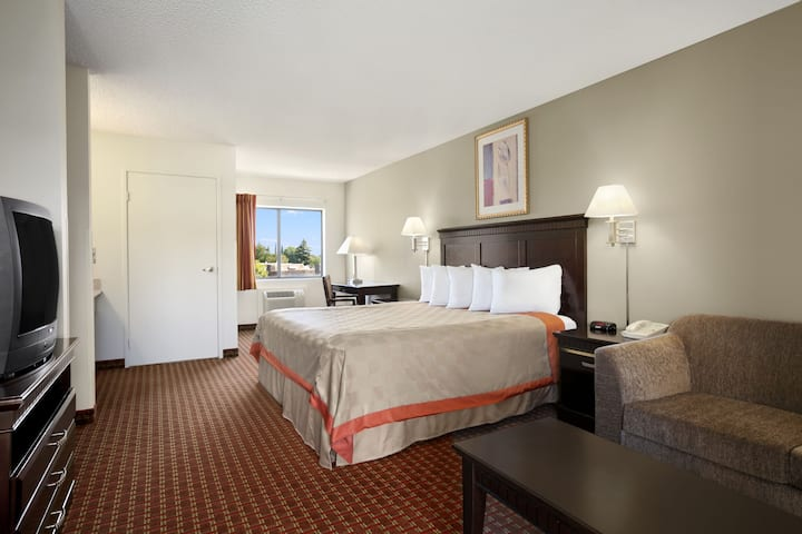 Guest room at the Days Inn & Suites Rancho Cordova in Rancho Cordova, California