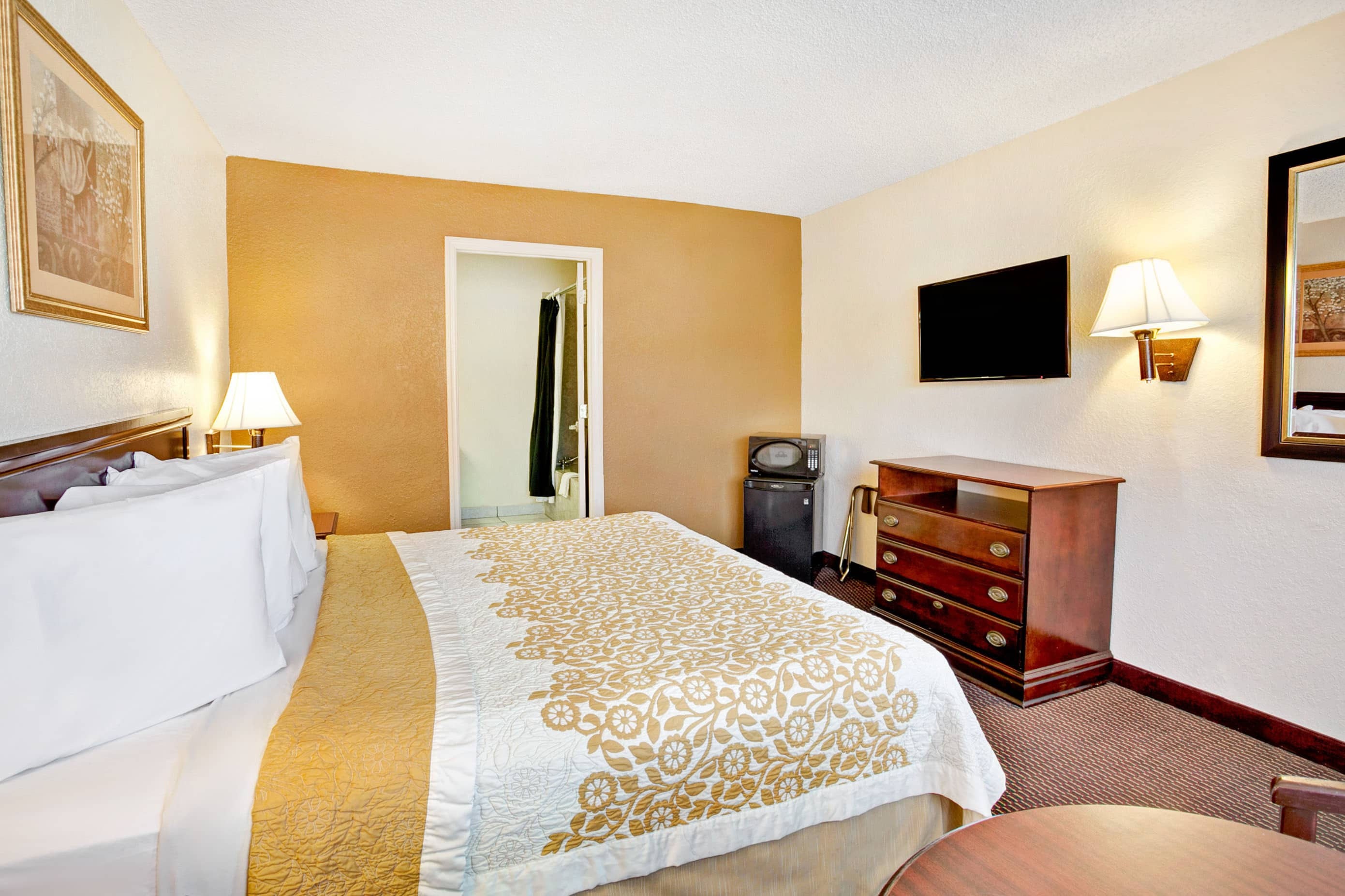 Guest room at the Days Inn & Suites Orlando/UCF Area Research Park in Orlando, Florida