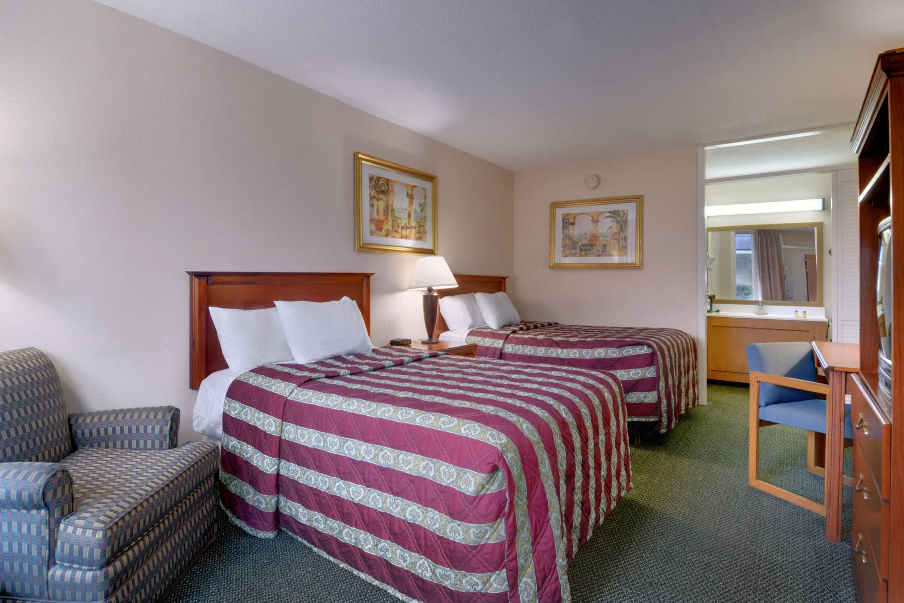 Guest room at the Days Inn Silver Springs/Ocala East in Silver Springs, Florida