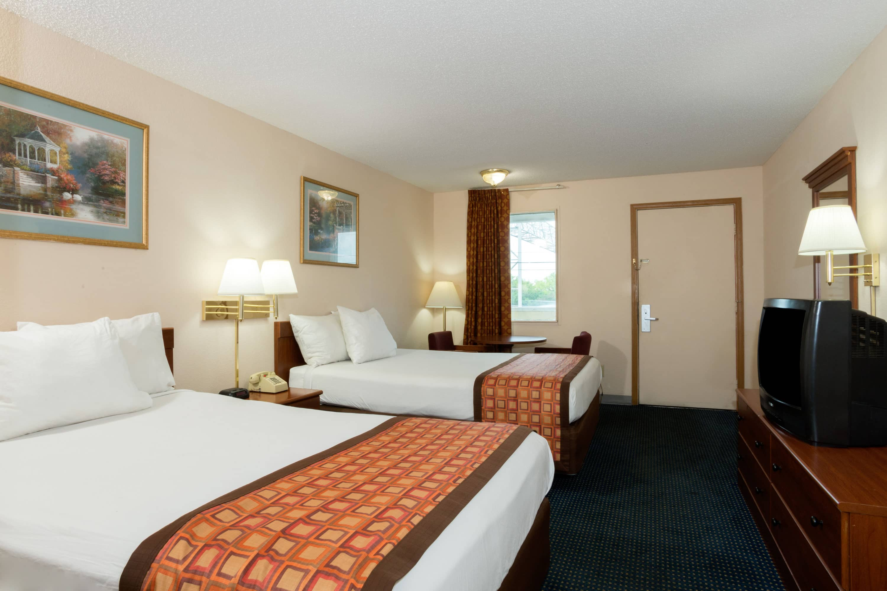 Guest room at the Days Inn Indianapolis East Post Road in Indianapolis, Indiana