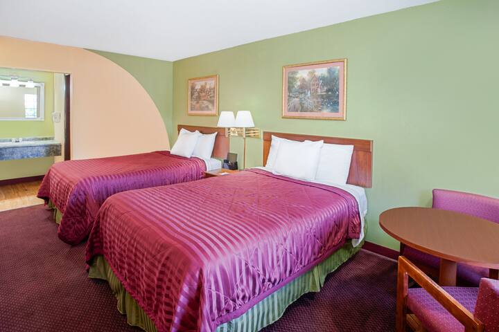 Guest room at the Days Inn & Suites Terre Haute in Terre Haute, Indiana