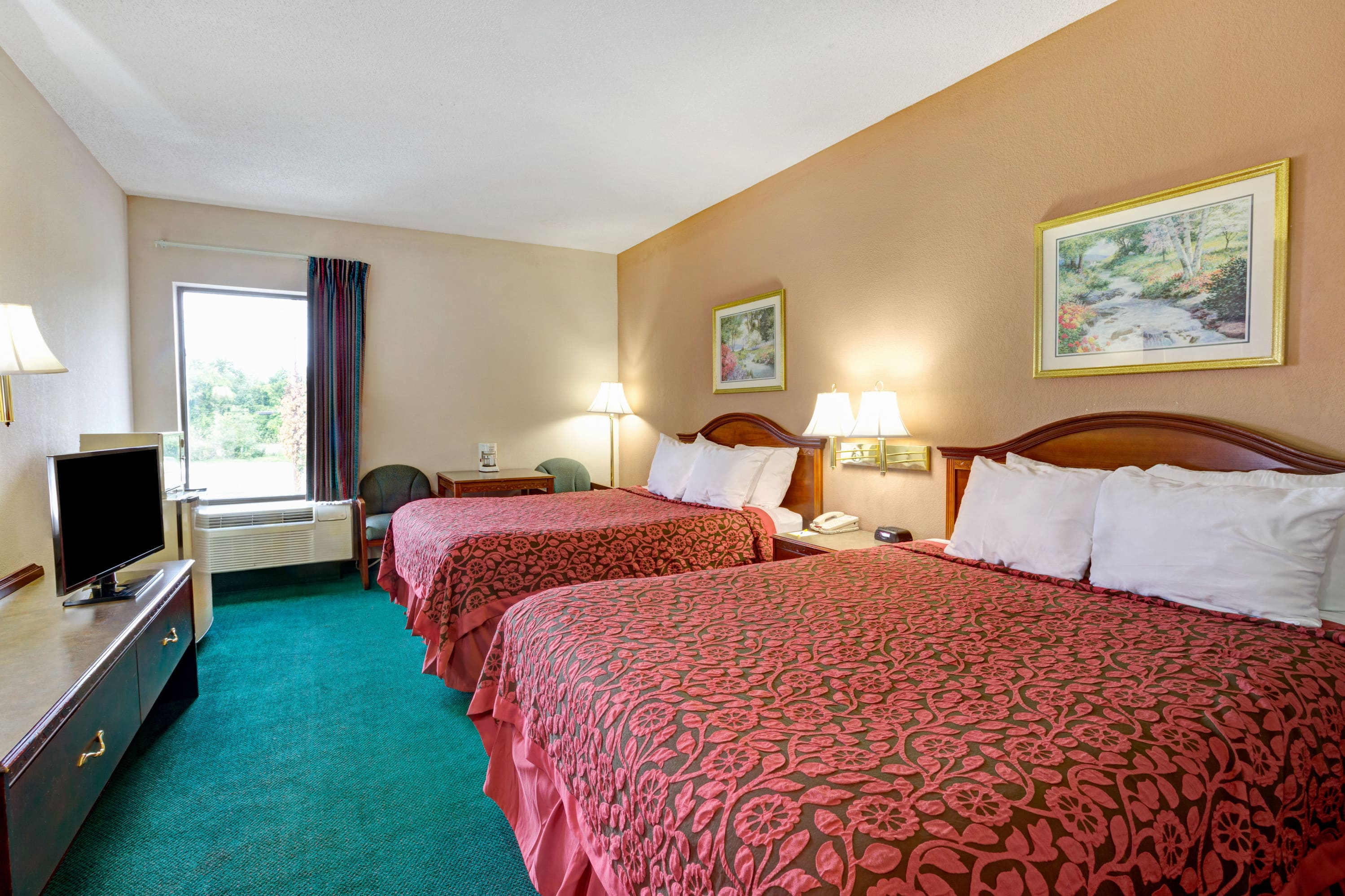 Guest room at the Days Inn & Suites Louisville SW in Louisville, Kentucky