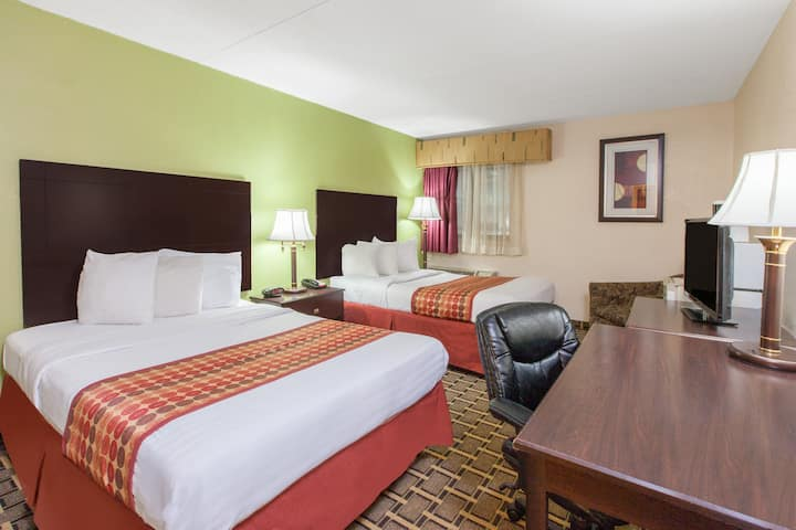 Guest room at the Days Inn & Suites Madison Heights MI in Madison Heights, Michigan