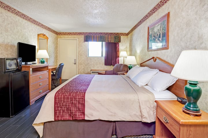 Guest room at the Days Inn & Suites Monroe in Monroe, Michigan