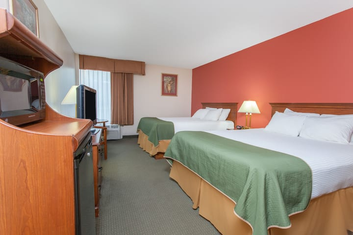 Guest room at the Days Inn & Suites Mt Pleasant in Mount Pleasant, Michigan