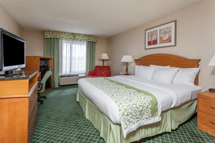 Guest room at the Days Inn & Suites Warren in Warren, Michigan