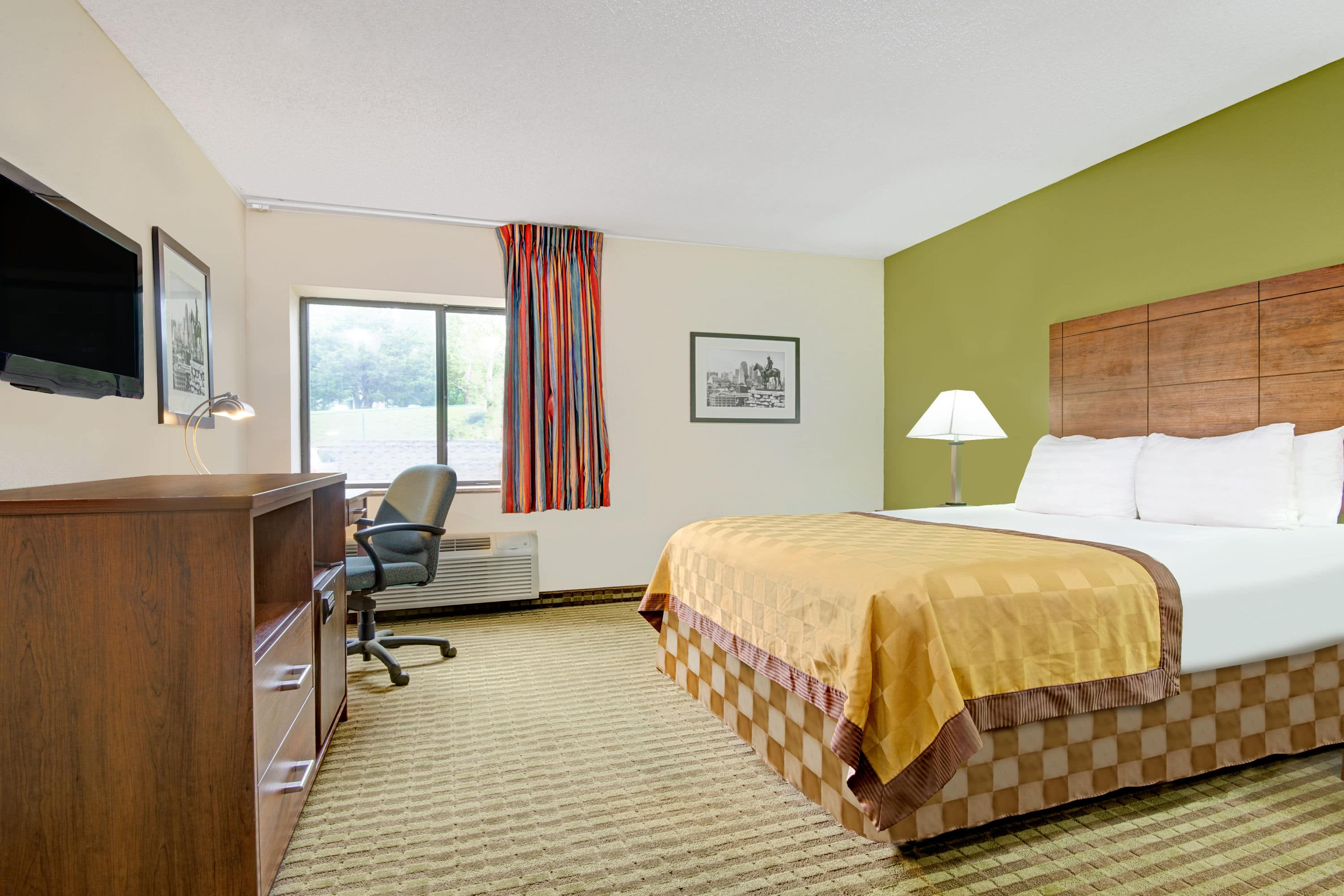 Guest room at the Days Inn & Suites Kansas City South in Kansas City, Missouri