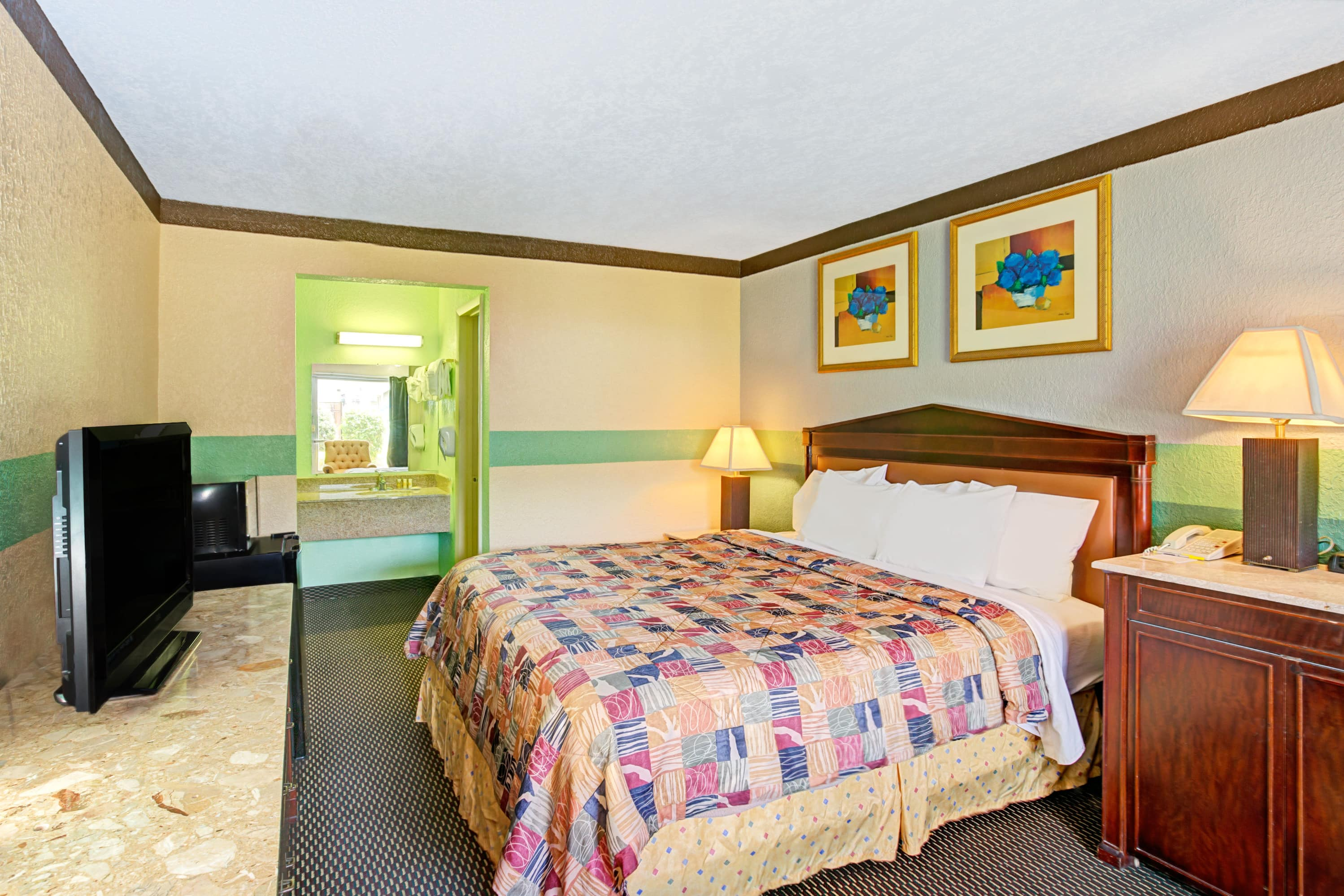 Guest room at the Days Inn Charlotte North-Speedway-UNCC-Research Park in Charlotte, North Carolina
