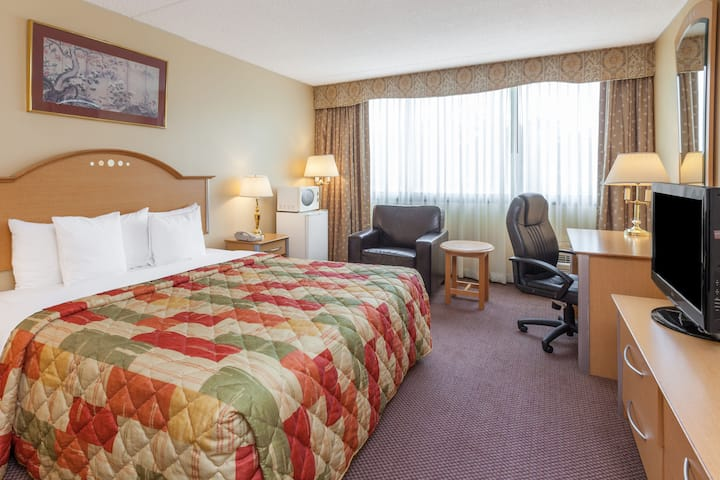Guest room at the Days Hotel Conference Center East Brunswick in East Brunswick, New Jersey