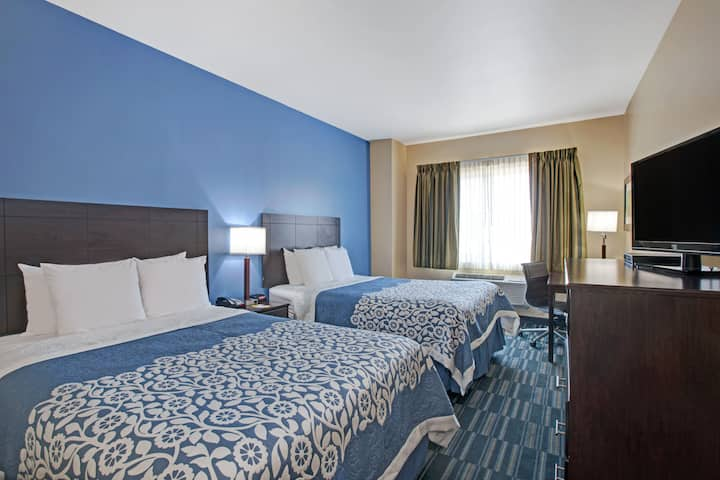 Guest room at the Days Inn & Suites Ozone Park/JFK Airport in Ozone Park, New York