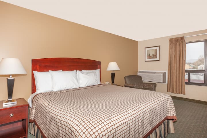 Guest room at the Days Inn Utica in Utica, New York