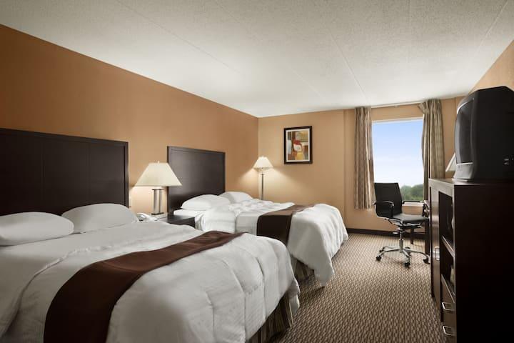 Guest room at the Days Inn & Suites Cincinnati in Cincinnati, Ohio