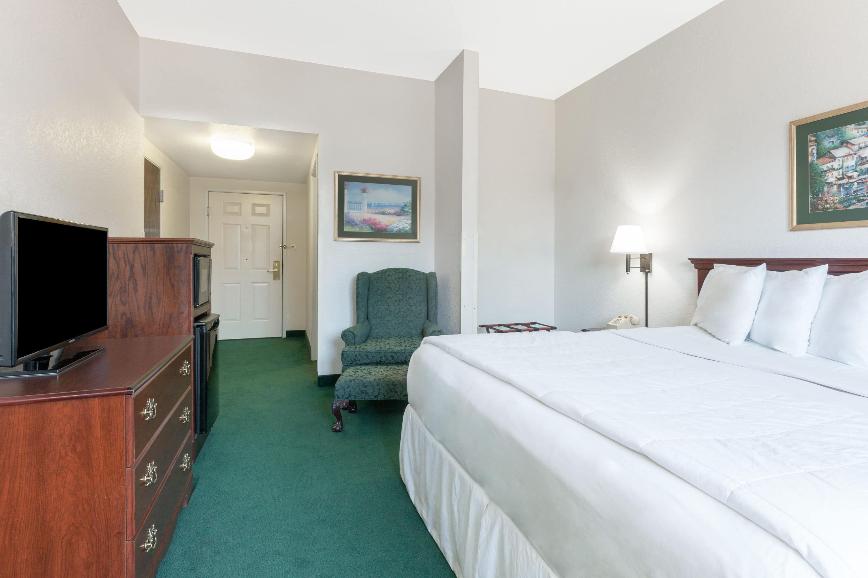 Guest room at the Days Inn & Suites Poteau in Poteau, Oklahoma