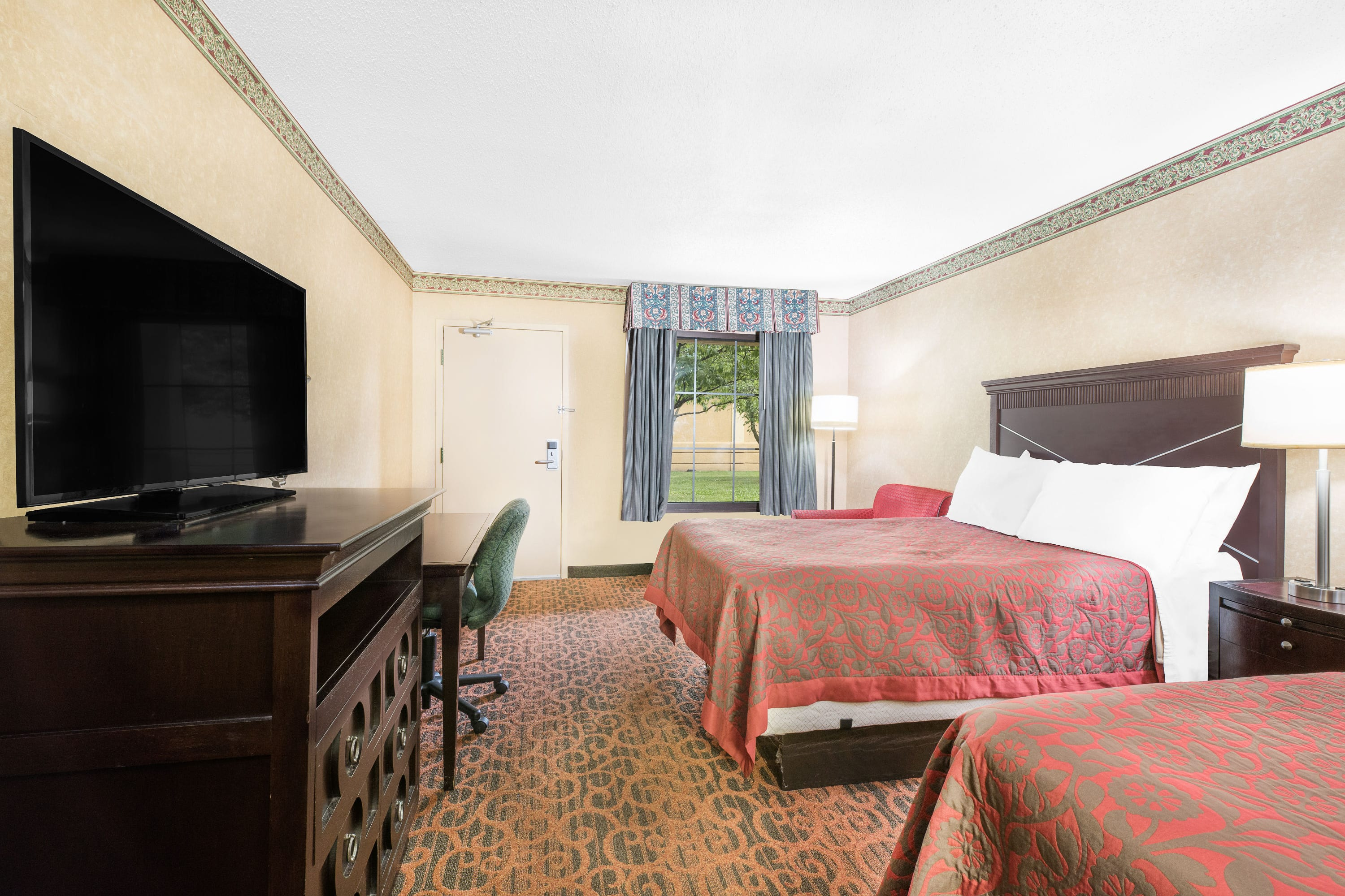 Guest room at the Days Inn & Suites York in York, Pennsylvania