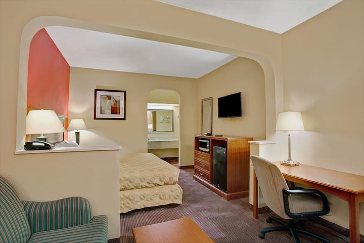 Guest room at the Days Inn & Suites Memphis East in Memphis, Tennessee