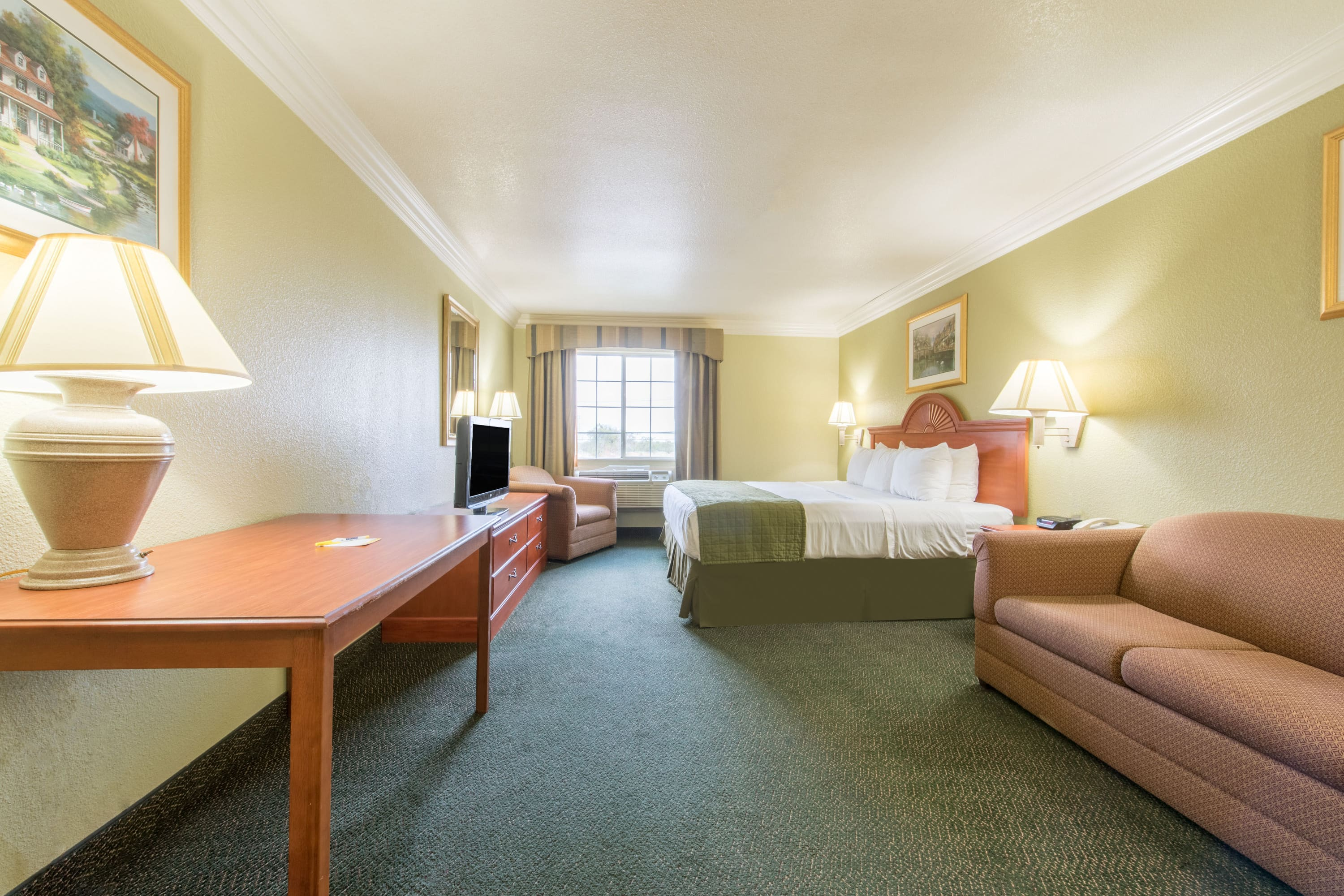 Guest room at the Days Inn Benbrook Fort Worth Area in Benbrook, Texas