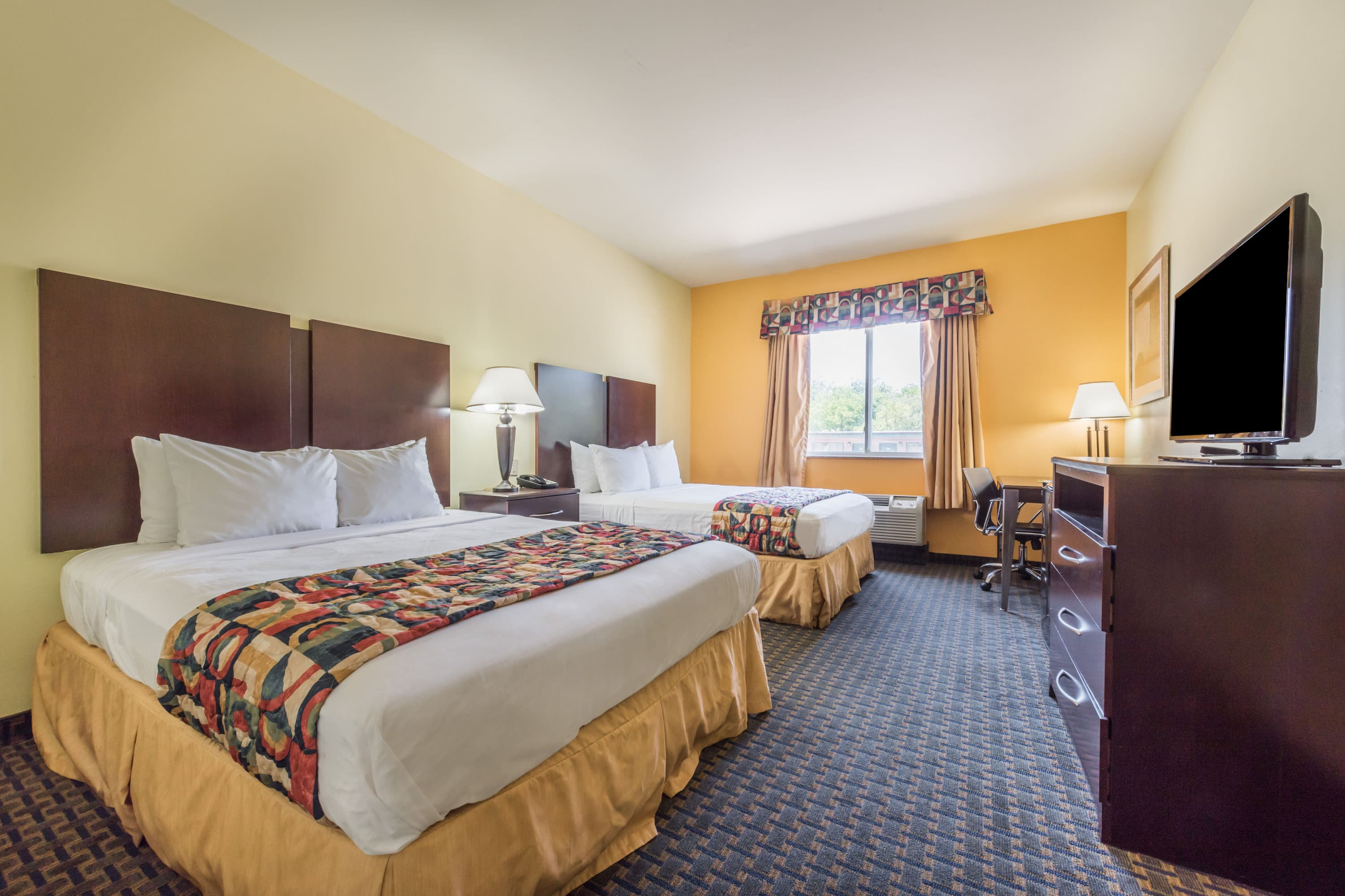 Guest room at the Days Inn & Suites Cleburne TX in Cleburne, Texas