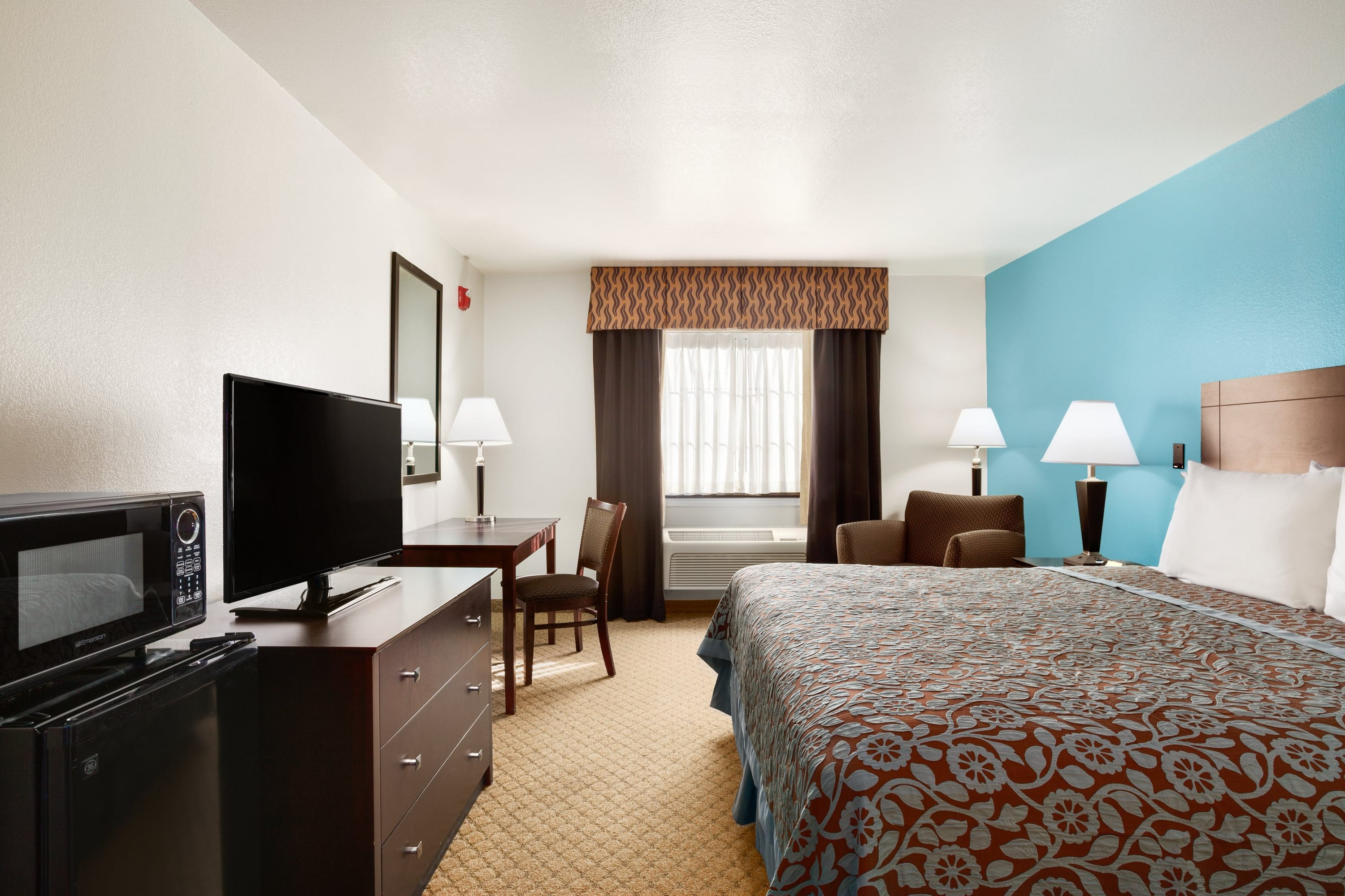 Guest room at the Days Inn & Suites Conroe North in Conroe, Texas