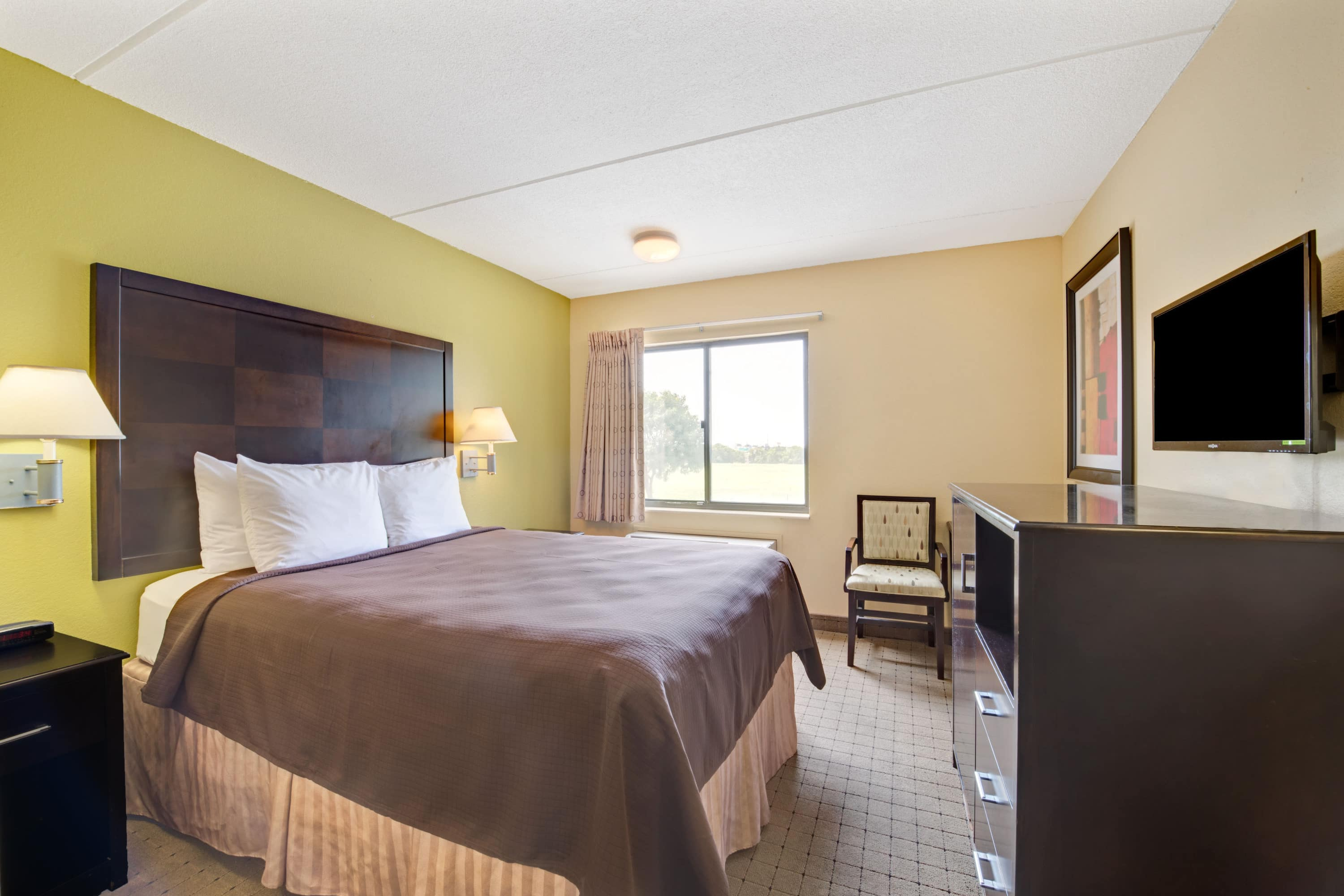 Guest room at the Days Inn & Suites DeSoto in DeSoto, Texas