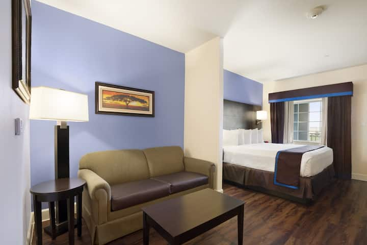 Guest room at the Days Inn & Suites Galveston West/Seawall in Galveston, Texas