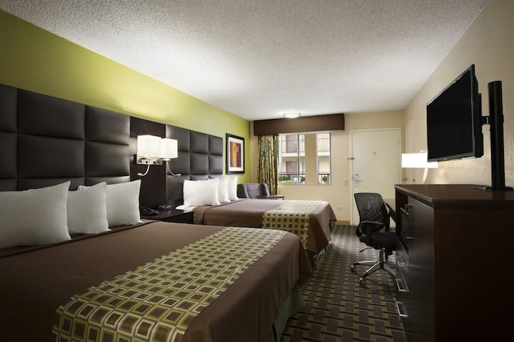 Guest room at the Days Inn by Wyndham Dallas Irving Market Center in Irving, Texas