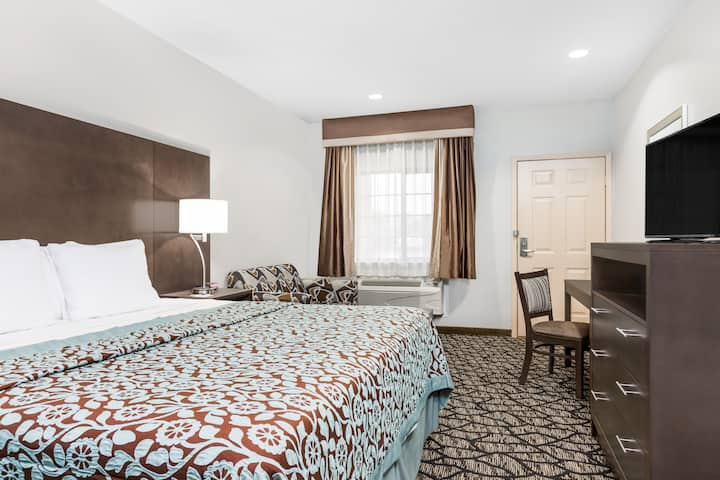 Guest room at the Days Inn & Suites Madisonville in Madisonville, Texas