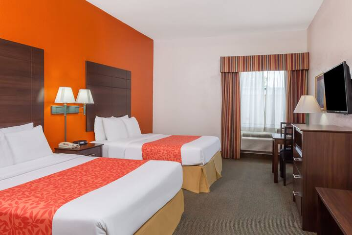Guest room at the Days Inn & Suites Pasadena in Pasadena, Texas