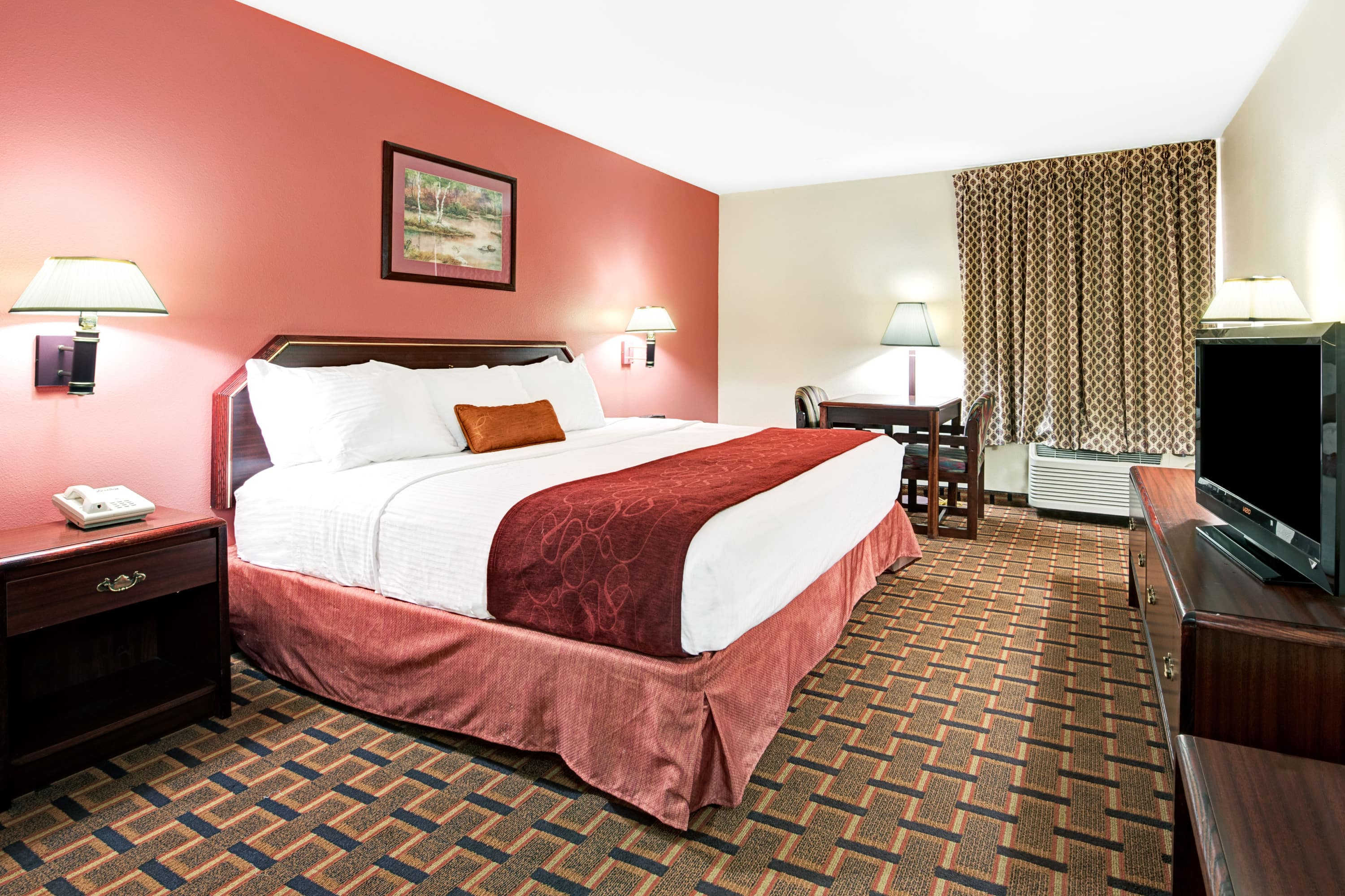 Guest room at the Days Inn Dallas Plano in Plano, Texas