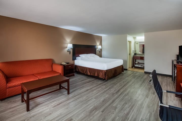 Guest room at the Days Inn and Suites Tyler in Tyler, Texas