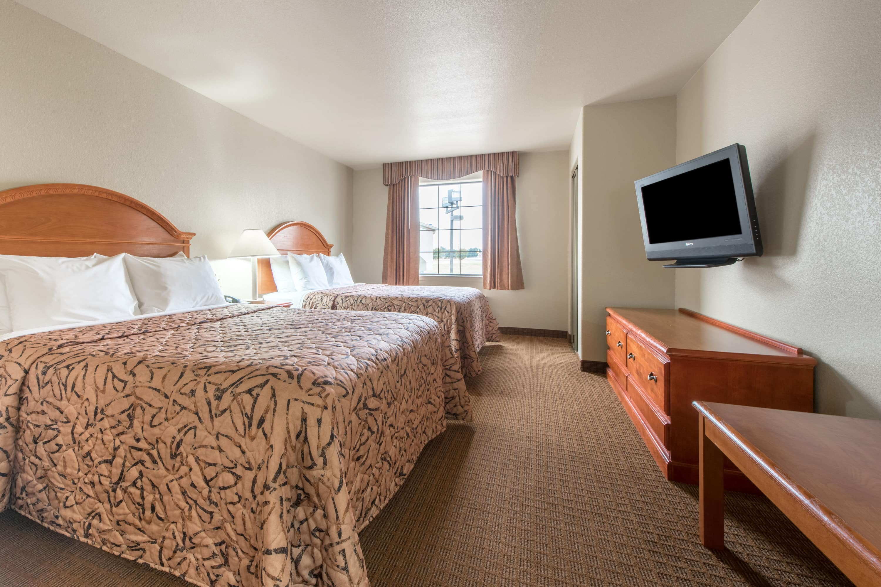 Guest room at the Days Inn & Suites Wichita Falls in Wichita Falls, Texas