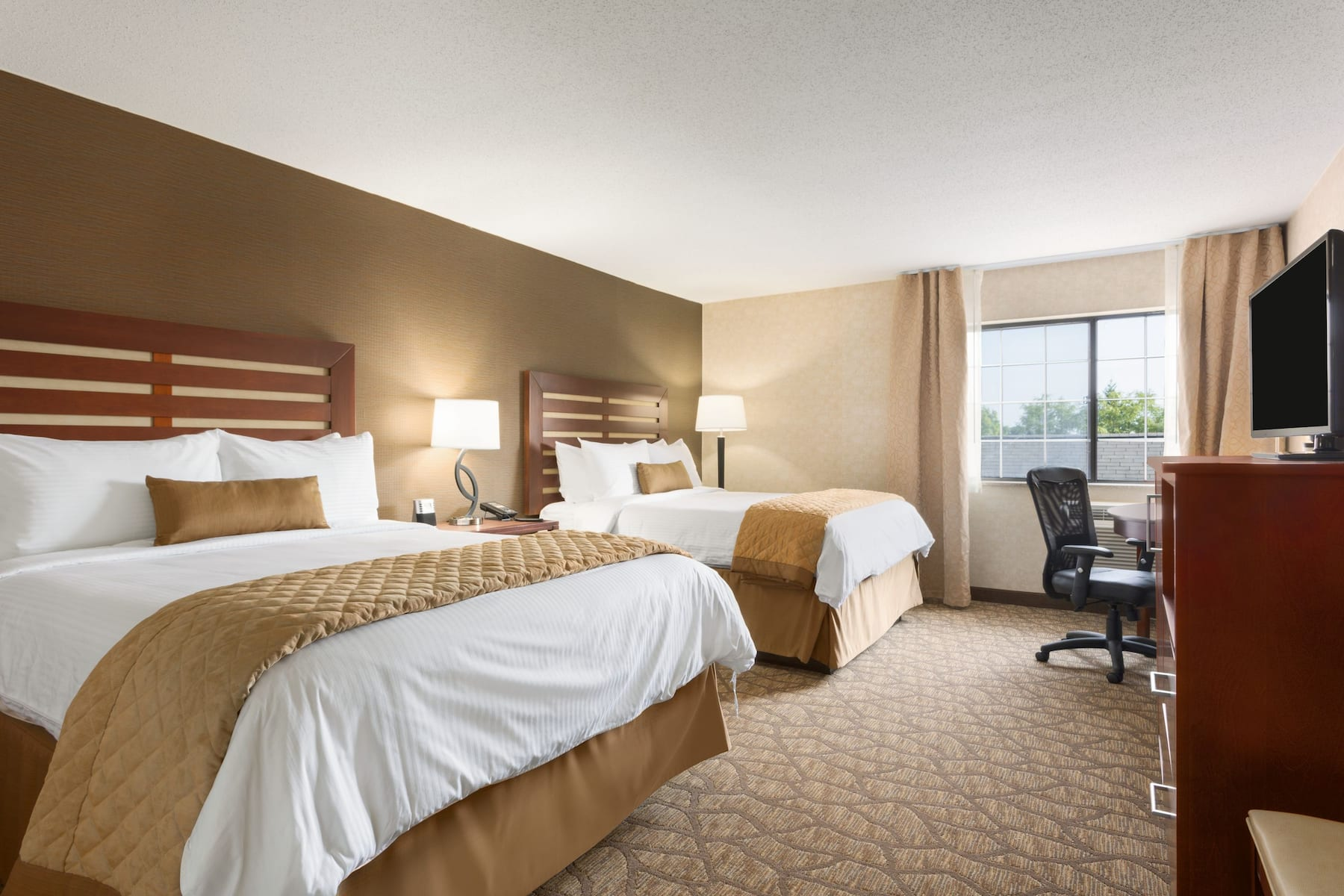 Guest Room At The Wyndham Garden Grand Rapids Airport In