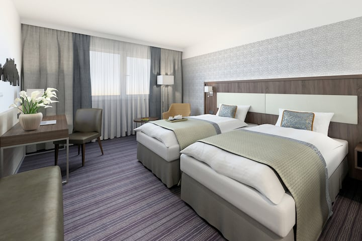 Guest room at the Wyndham Grand Salzburg Conference Centre in Salzburg, Other than US/Canada