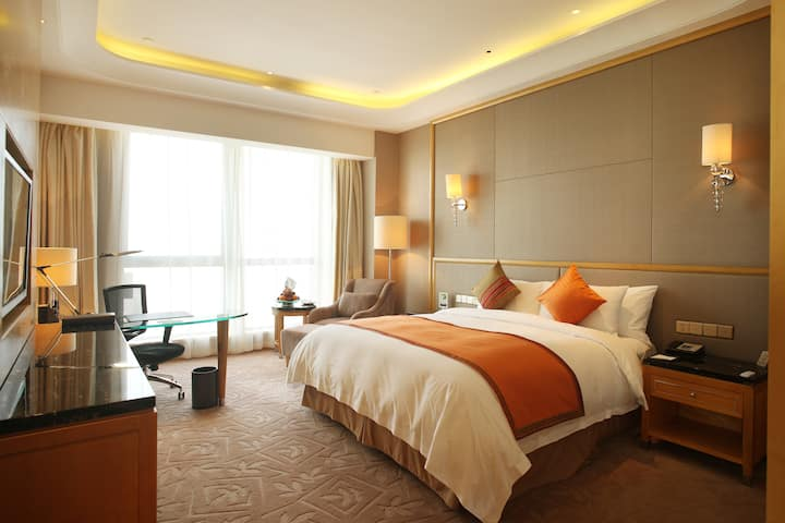 Guest room at the Wyndham Grand Plaza Royale Changsheng Jiangyin in Jiangyin, Other than US/Canada