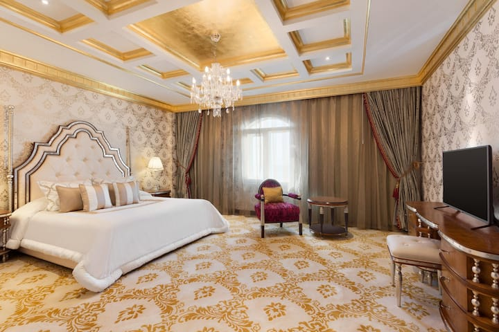 Guest room at the Wyndham Grand Regency Doha in Doha, Other than US/Canada