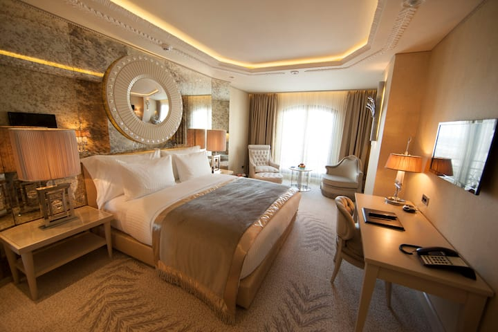 Guest room at the Wyndham Grand Istanbul Kalamis Marina Hotel in Istanbul, Other than US/Canada