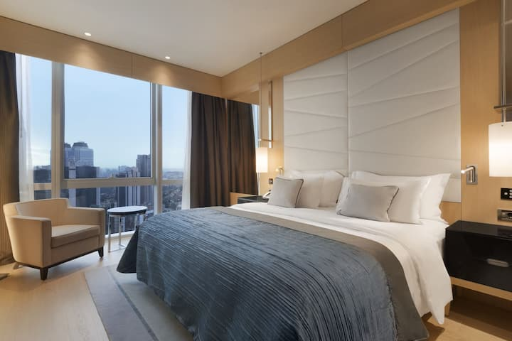 Guest room at the Wyndham Grand Istanbul Levent in Istanbul, Other than US/Canada