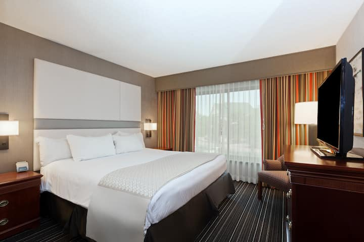 Guest room at the Wyndham Dallas Suites - Park Central in Dallas, Texas