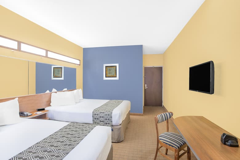Guest Room At The Microtel Inn Suites By Wyndham Chili Rochester Airport In
