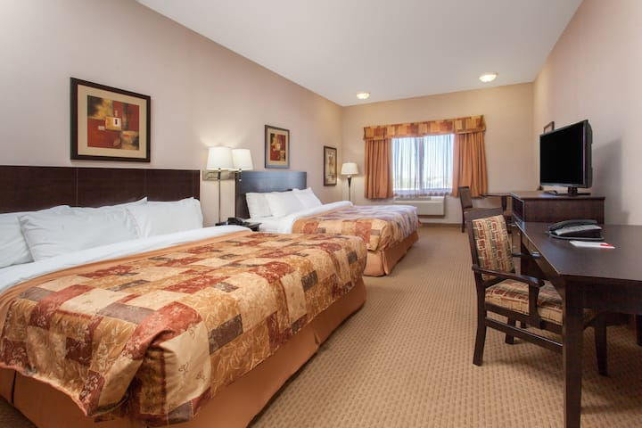 Guest room at the Ramada Brooks in Brooks, Alberta