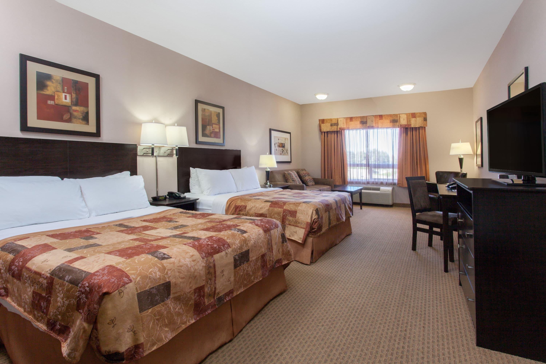 Guest room at the Ramada Brooks in Brooks, Alberta