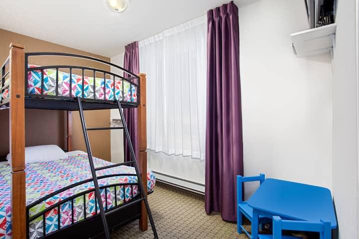 Guest room at the Ramada Red Deer Hotel and Suites in Red Deer, Alberta