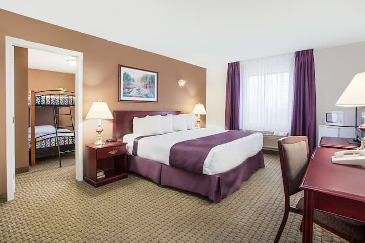 Guest room at the Ramada Red Deer Hotel and Suites in Red Deer, Alberta