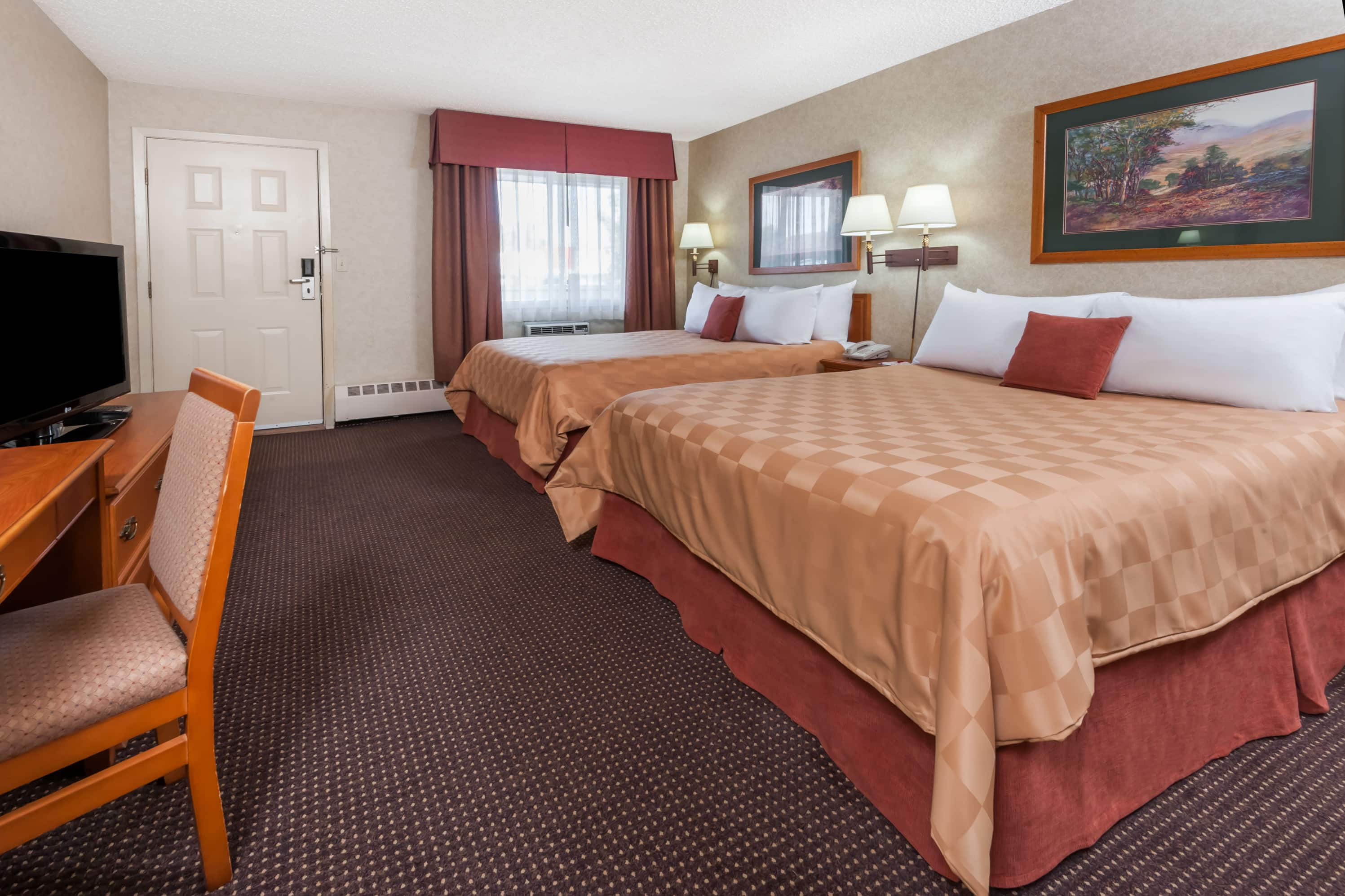 Guest room at the Ramada Stony Plain Hotel & Suites in Stony Plain, Alberta