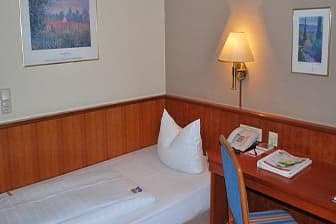 Guest room at the Ramada Mannheim in Mannheim, Other than US/Canada