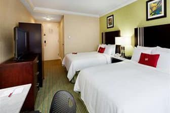 Guest room at the Ramada Plaza Holtsville Long Island in Holtsville, New York