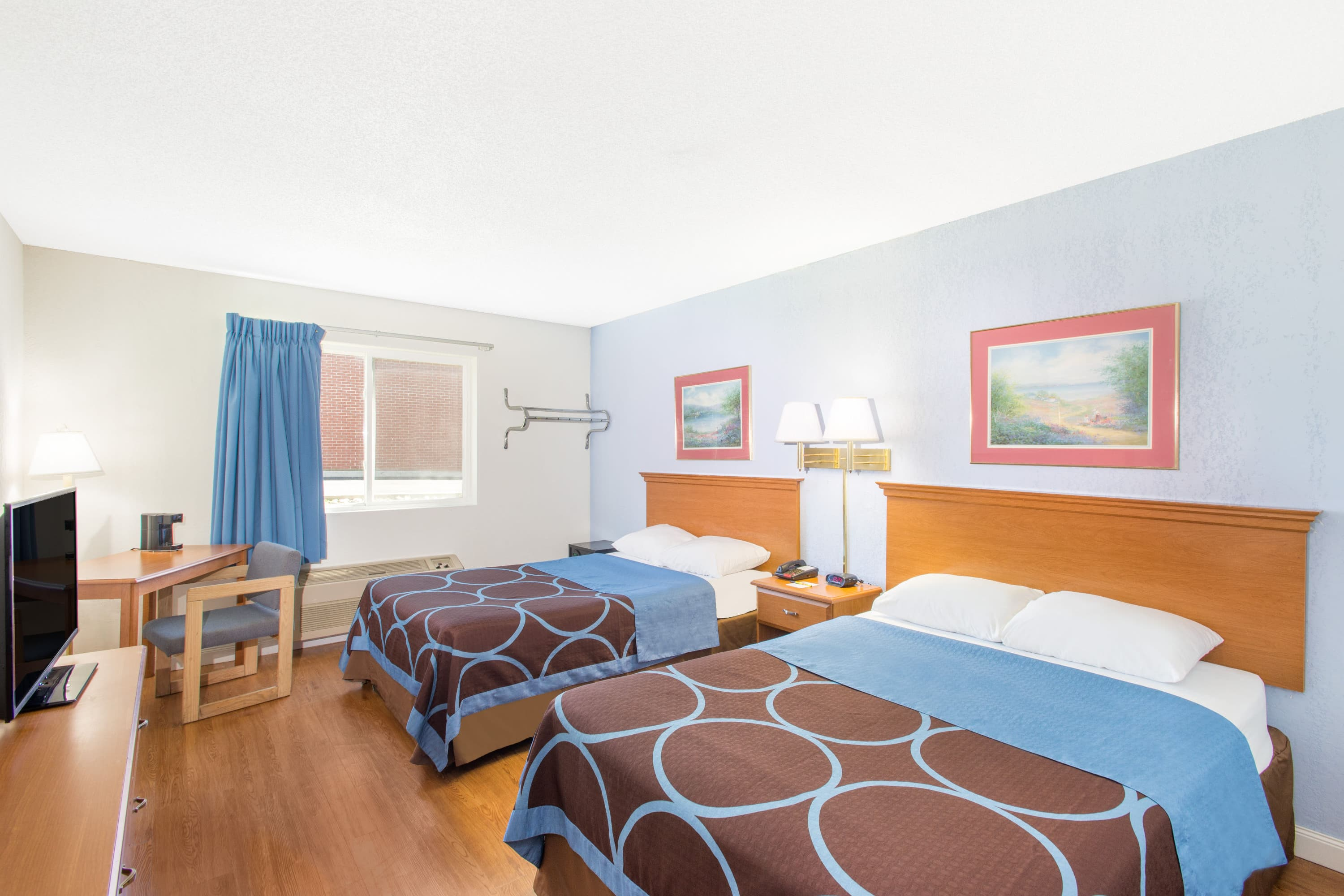 Guest room at the Super 8 by Wyndham Webster/Rochester in Webster, New York